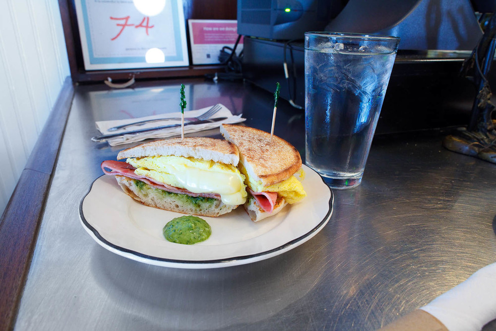 Penny Egg Sandwich - scrambled eggs with american cheese, pesto, and ham on an english muffin ($8)