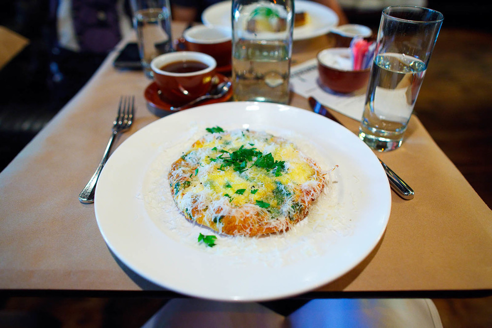 Seasonal frittata with ricotta cheese, sprinkled parmesan ($16)