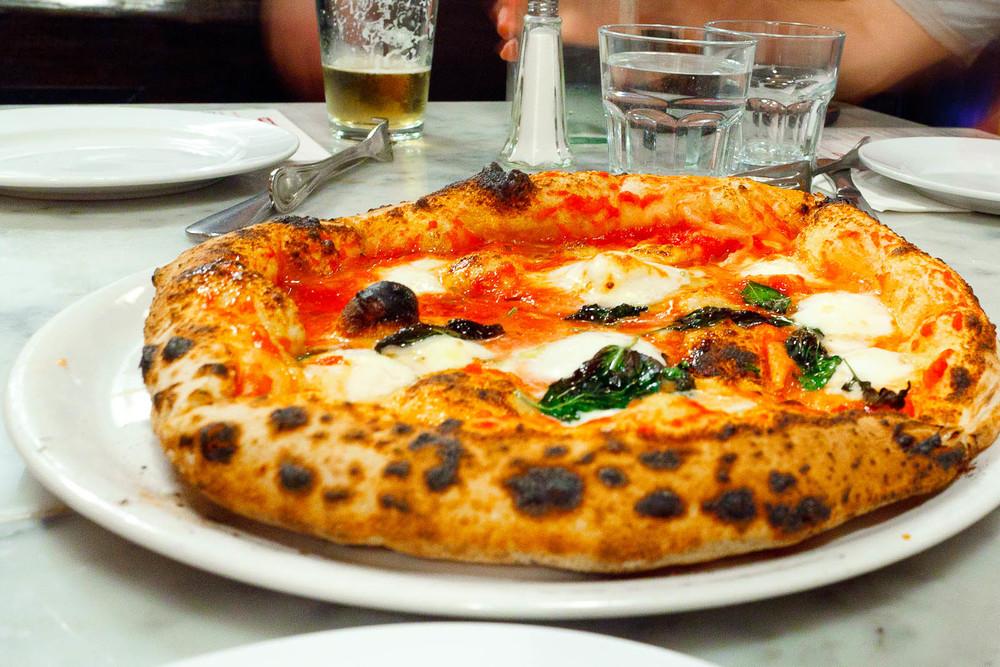 Pizza Margherita - tomato, mozzarella di bufala, basil ($13)