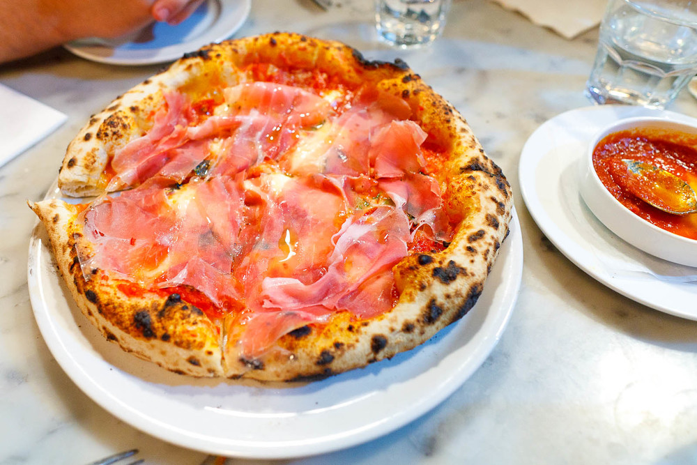 Soppressata Picante with prosciutto - tomato, fior di latte, spicy soppressata, chili flakes, garlic ($14)
