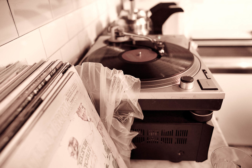 Analog. Technics 1200s with vintage records.