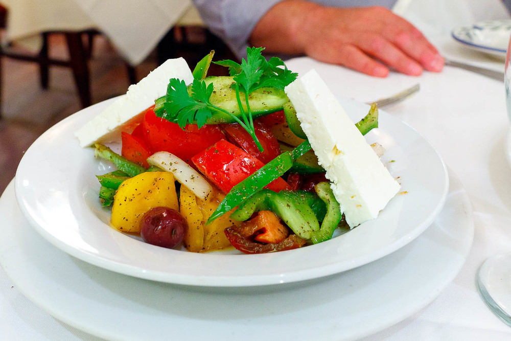 Greek salad - classic salad with vine-ripened tomato, cucumber, pepper, onions, Kalmata olives, and feta cheese ($15.95)