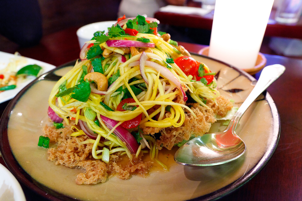 Crispy catfish salad with green mango and spicy lime dressing ($15)