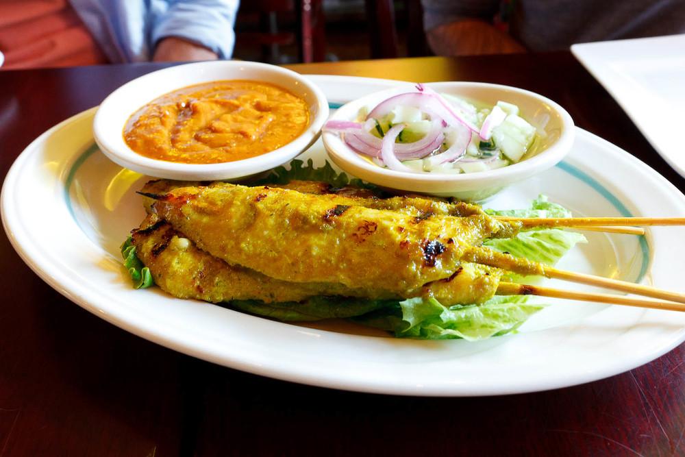 Satay chicken with peanut and cucumber sauce ($7)