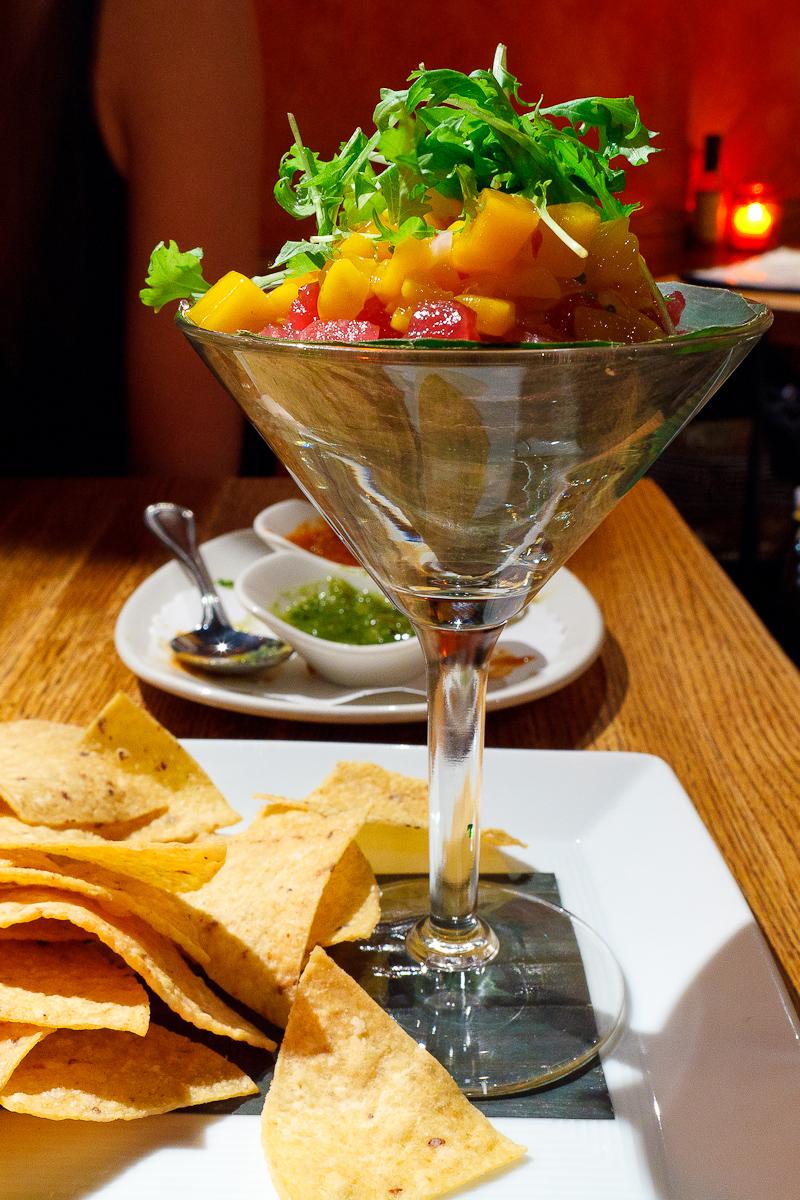 Coctel de atún tropical, sashimi-grade Hawaiian bigeye tuna, avocado-tomatillo guacamole, tangy mango-grapefruit salsa ($14)