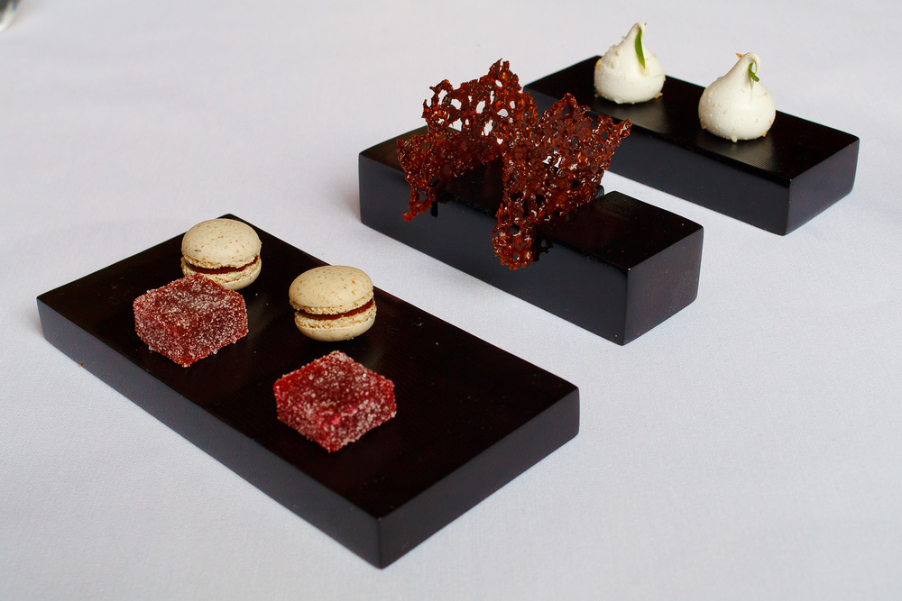 Petits Fours: Raspberry pâtes de fruits, chocolate macaron, cacao nib tuiles, passionfruit meringue