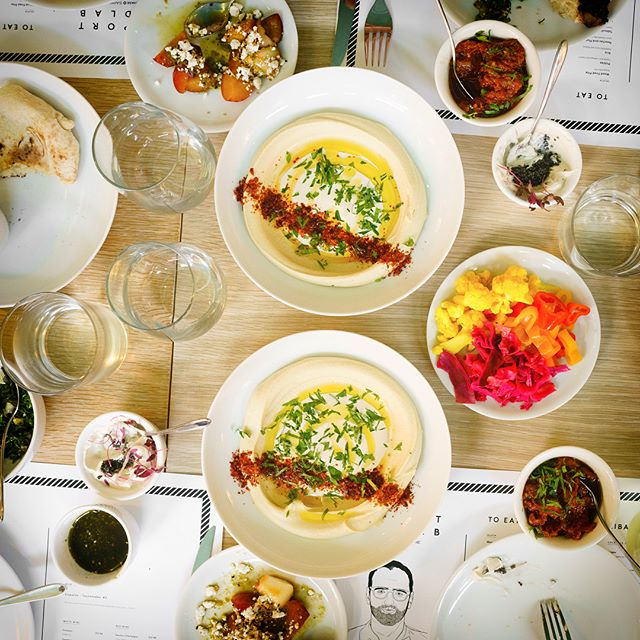 "Photos from Alon Shaya'spopup at New York's Seaport FoodLab. Shaya won the James Beard for ""Best New Restaurant"" last year. The Food Labis a part of theSeaport Summerandispresentedby @Chase #SapphireOnLocation.#sponsored  1. Wood fired pita, za'atar olive oil, hummus tahini  2. Glass of Veuve Cliquot  3. Kibbeh Nayah: Wagyu beef tartar w/ pomegranate molasses, Yemenite flatbread  4. Shakshouka: farm eggs, eggplant, chanterelles and Zhoug  5. Red Snapper Chraime: wood roasted summer squash, freeman, green tahini  6. Short Rib Tagine: Semolina cos cons, pistachio, figs, black garlic harissa  7. Apricot Babka, cardamom gelato & sour cherry  8. Pecan baklava: Smoked cinnamon bahamas  9. The dinner  10. Portrait of chef Alon Shaya"