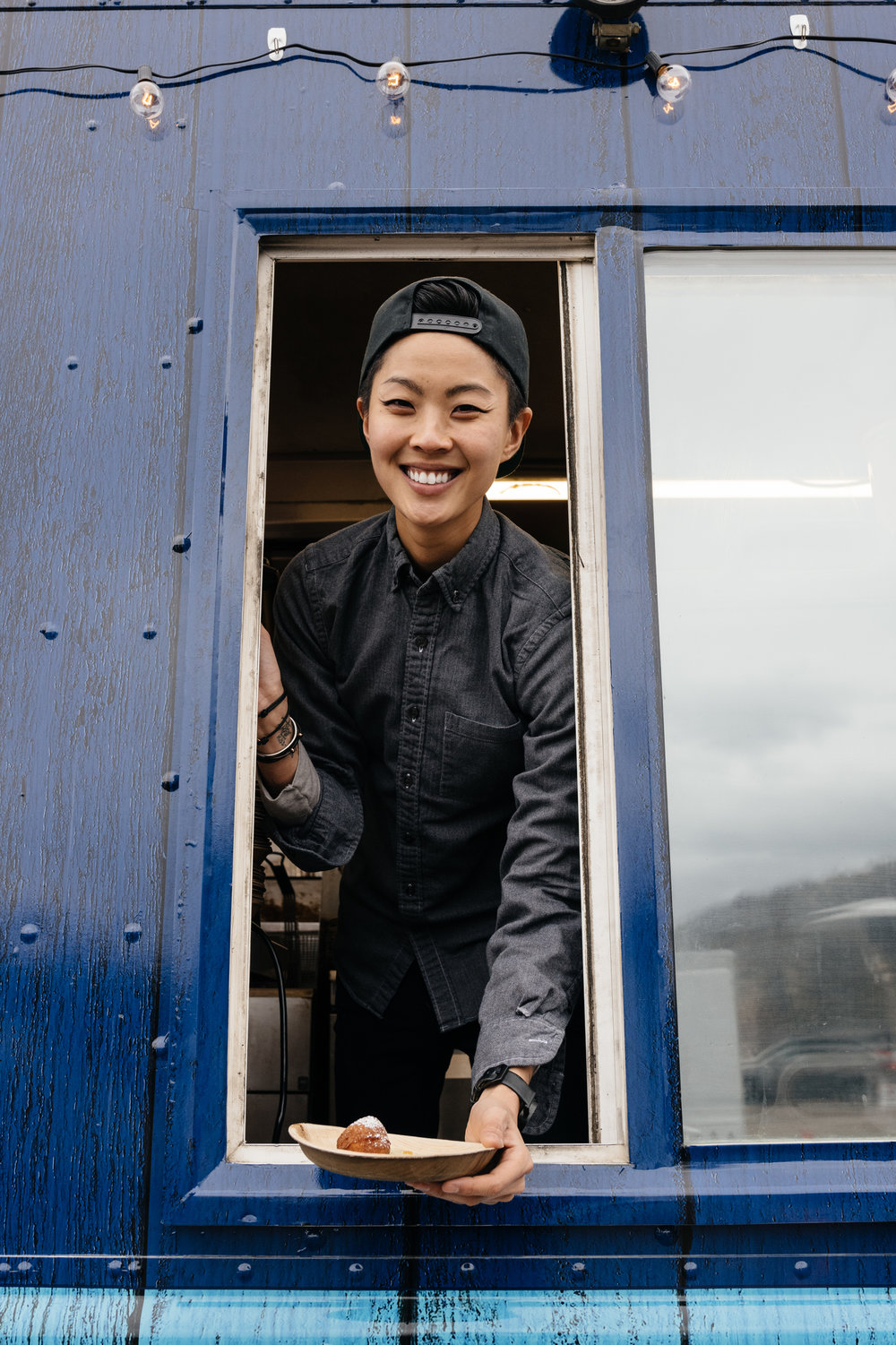 Chef Kristen Kish serving ricotta donuts from inside her food truck at Sundance Film Festival.