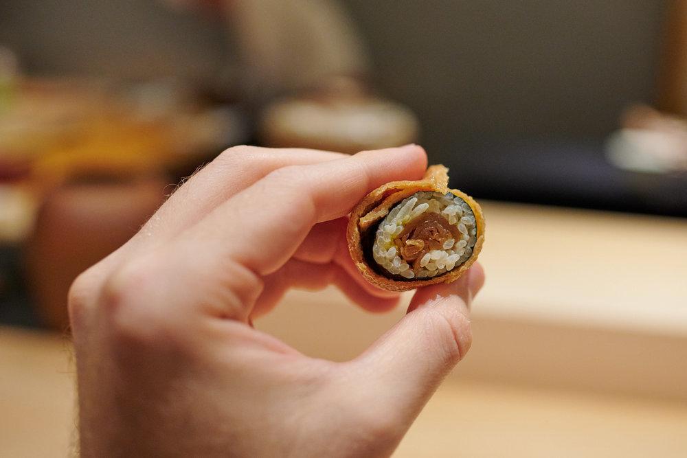 Pickled gourd sushi roll in seasoned tofu pouch (inari)