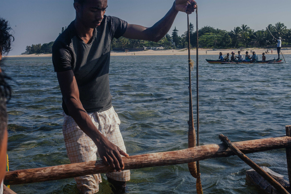 The man in charge of our canoe showing us a sea snake.