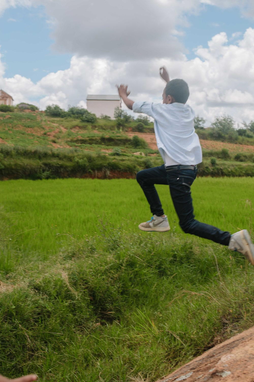 Manovo jumping across the fields.