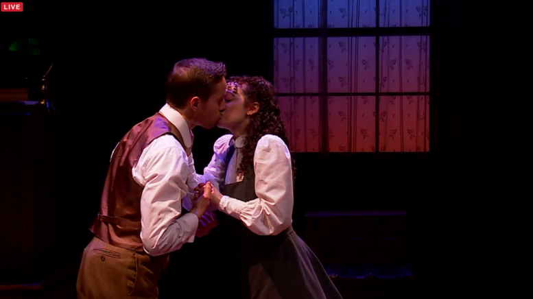 Adam Halpin and Megan McGinnis (who are married in real life) kiss during the second act of Daddy Long Legs.
