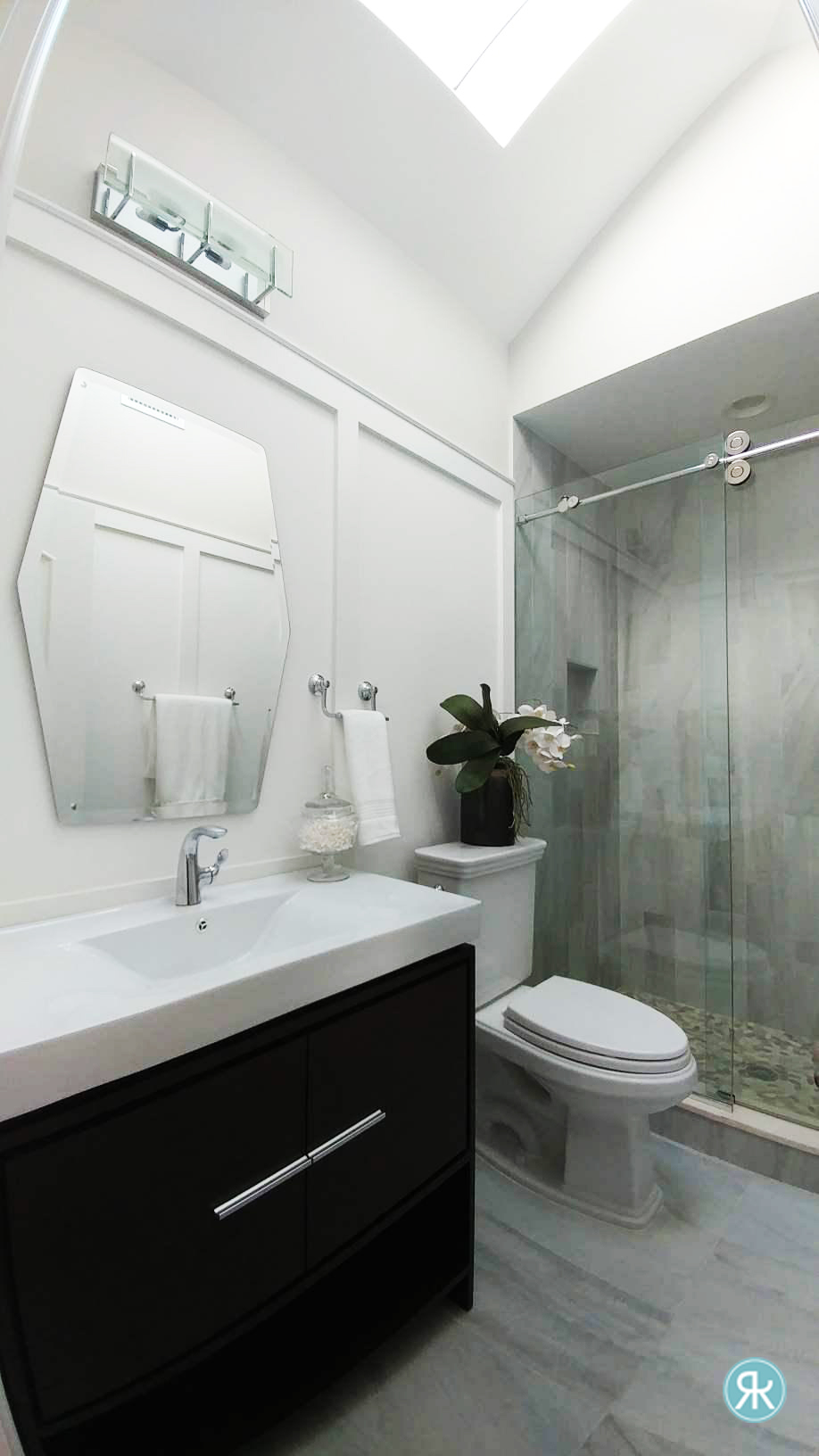 Bathroom-BlackandWhite-Minimal-Modern-Chic-Skylight-Mirror-Glass-Shower-Black-Vanity-Chrome-Charm-Wainscoting-Detail-InteriorDesign-Inpiration-Regina-Kay-Interiors.jpg