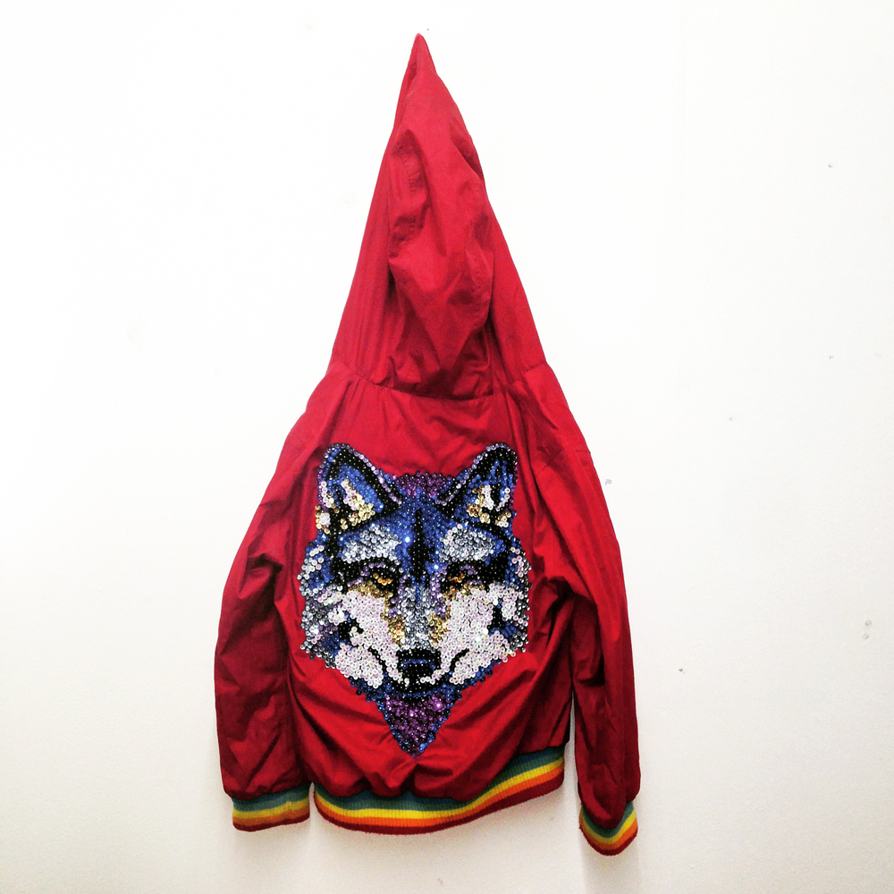 Hour of the Wolf 2016 Childrens Jacket with Sequins Inspired by the film 'The Wanderers' the work comprises a found children jacket and over a thousand sequins. It imagines one of a gang of tribalistic pre-teens whose emblematic and charasmatic uniform jacket has been fatetully mislaid.