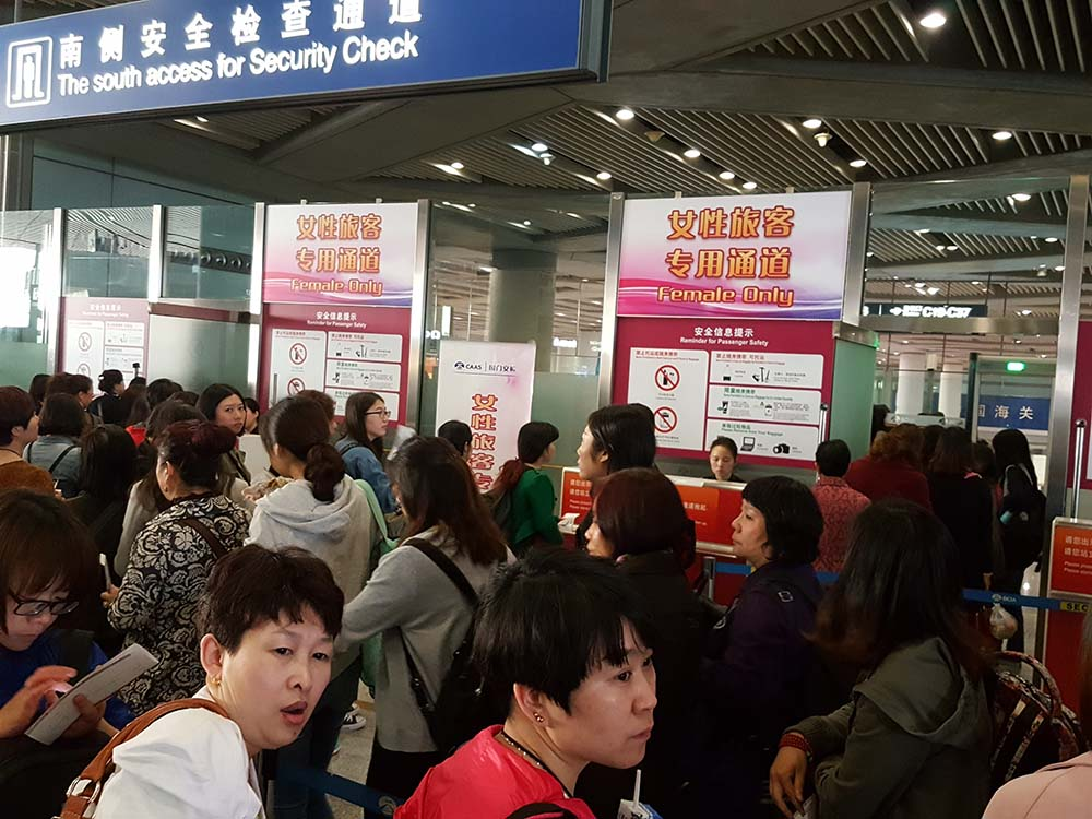 "The ""Female Only Lane"" at Beijing airport."