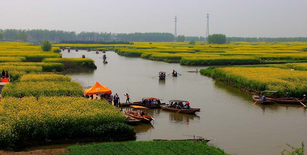 """The Land of Fish and Rice"" (Image source: club.china.com)"
