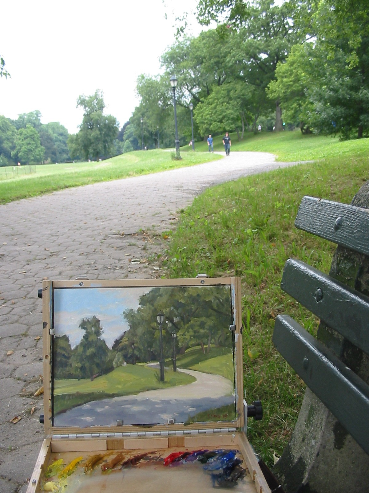 View of path and pochade box on park bench