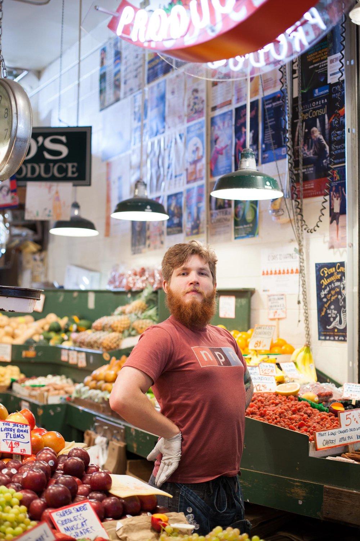 market-Seattle-worker-vegetables.jpg