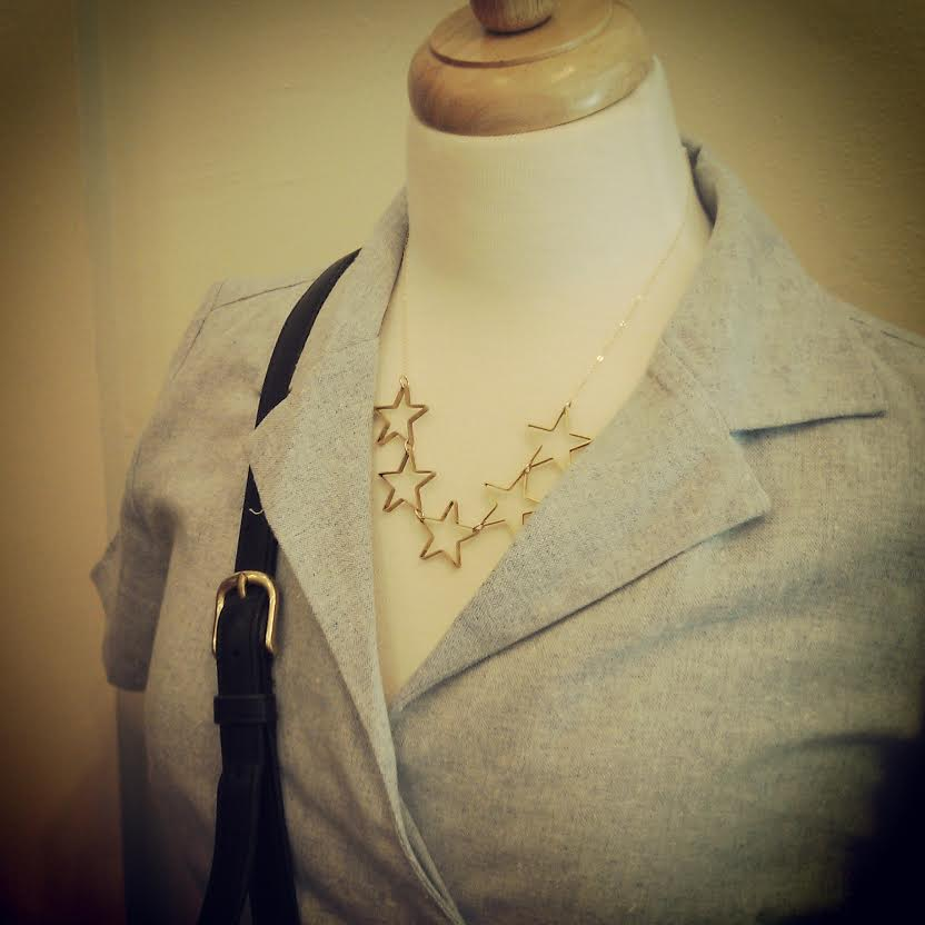 Star necklace by Lanaypi $54, Bride and Burn Dress Warp Dress $80, Vintage Coach Purse $72