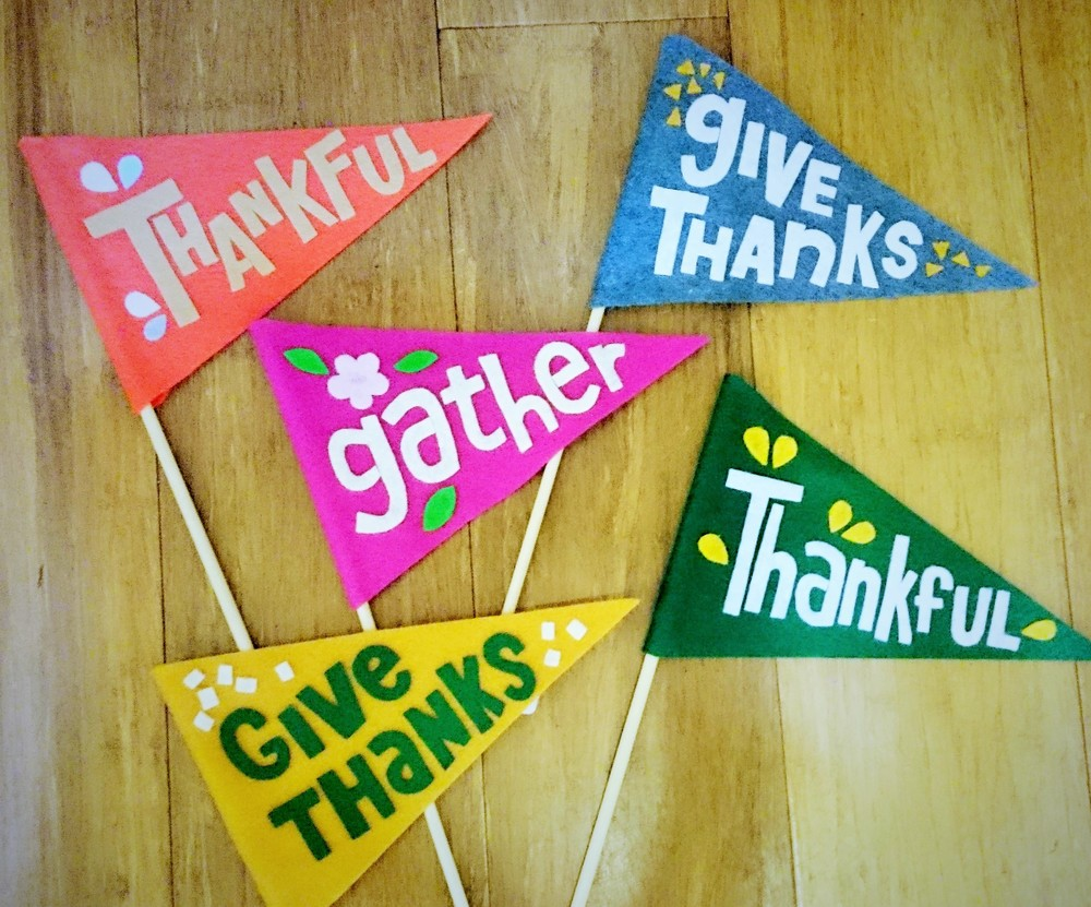Thanksgiving themed felt pennants made by Feed the Fish Co. Available in-store from $12.