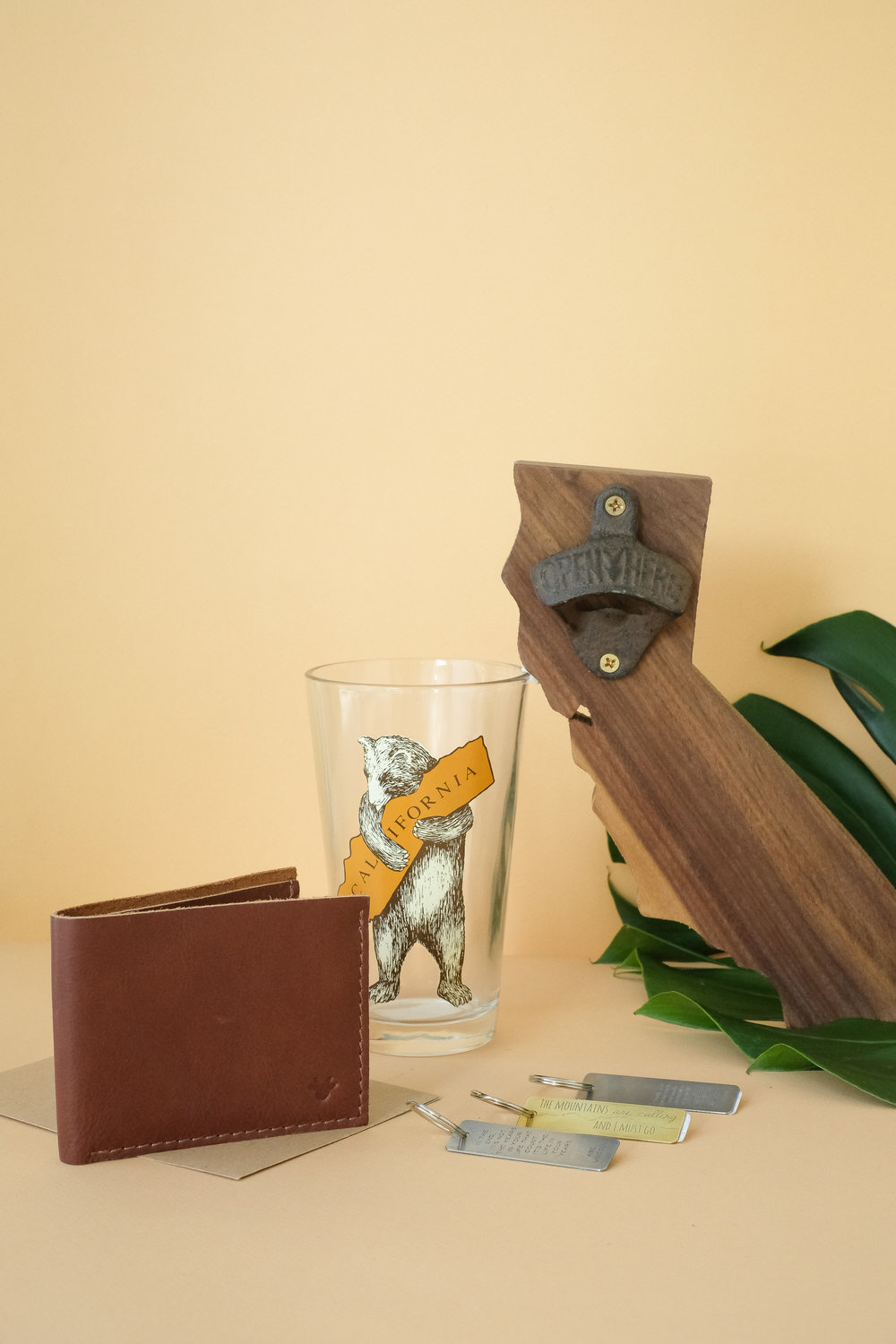 Kiko Wallet, Krista Tranquilla quote keychains, SF Mercantile bear pint glass, and California wooden bottle opener