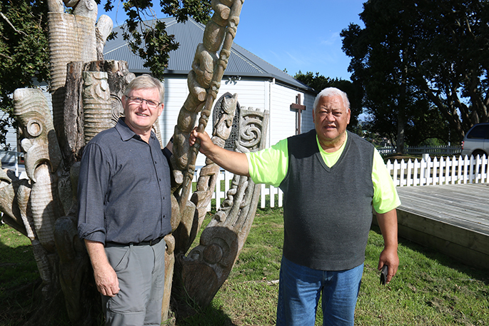 St George's Anglican Church congregation member Cliff Simons and Peri Kohu with a carving on the battle site. Photo: Tracy Hardy.