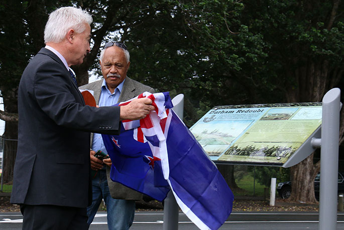 Tauranga Mayor Greg Brownless unveiling the plaque with Pukehinahina Charitable Trust project director Buddy Mikaere. Photos: Tracy Hardy.