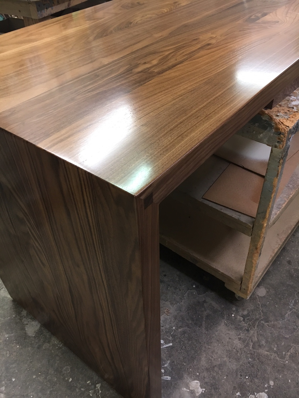 "Here is a shot of a custom 2"" thick solid black walnut countertop that our local craftsman made for us.  It's now installed as a ""swing off"" on the island.  Picture below..."