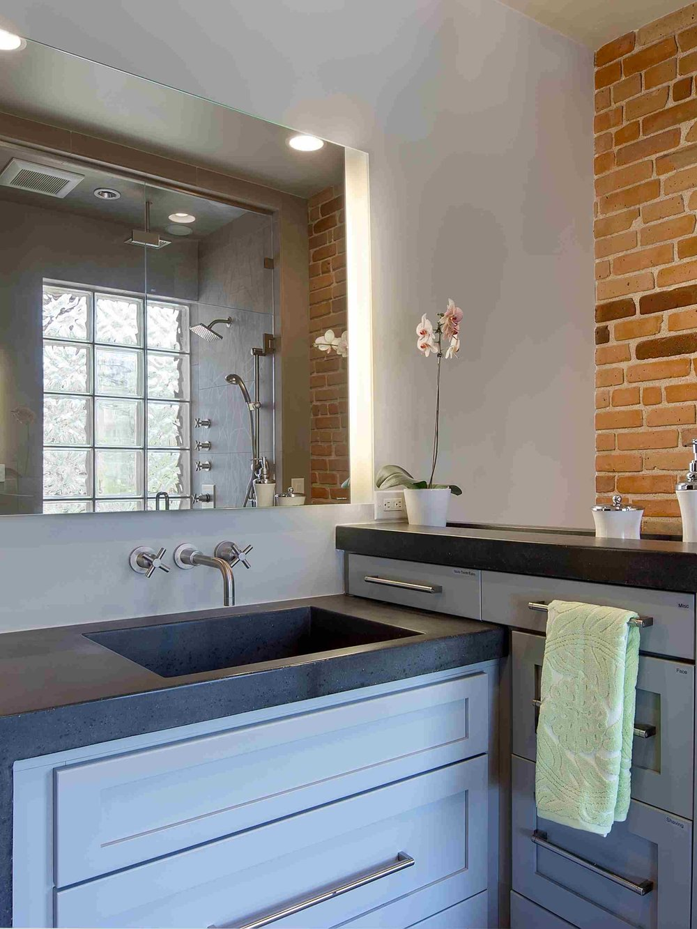 exposed brick and concrete — sanctuary kitchen and bath desi-2.jpg