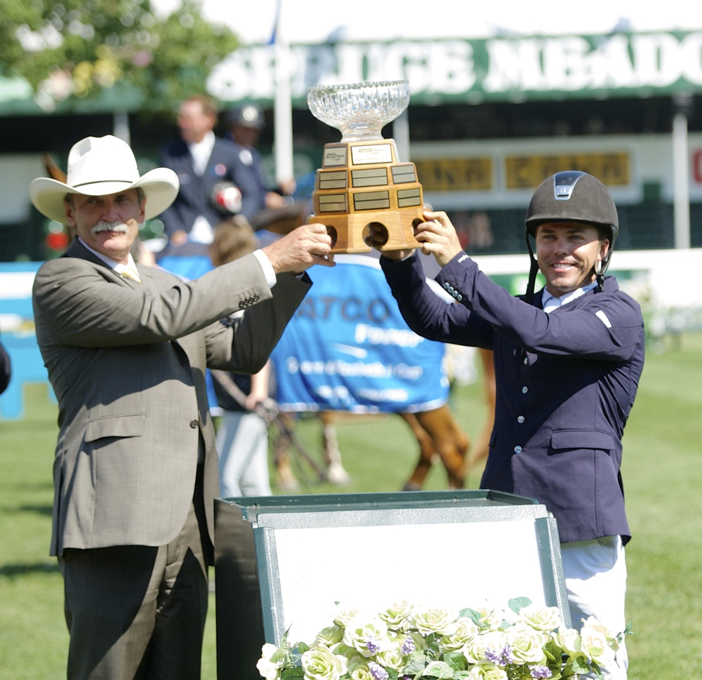 KENT FARRINGTON WINS PRESTIGIOUS ATCO POWER QUEEN ELIZABETH II CUP  On Saturday, July 5th, Kent Farrington rode to victory in the ATCO Power Queen Elizabeth II Cup, capturing his third Grand Prix in the past two Summer Series' at Spruce Meadows. Making the accomplishment even more remarkable was Farrington's decision to ride Voyeur in Saturday's Grand Prix instead of Uceko, the horse he had so much success with last season.    READ MORE