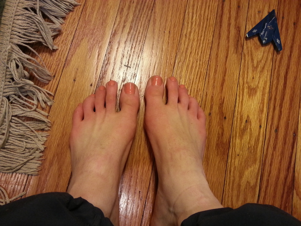 My feet, post-walk, with barely-red toes.