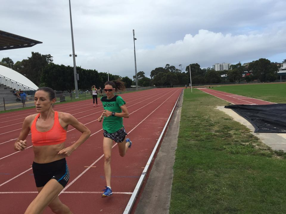 Madeline Heiner running loops on the track with me. She's a local Australian runner who can drop me no problem on the track!