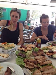 My sister and me enjoying some food in Brazil
