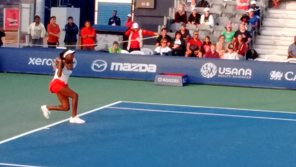Abanda returns a serve