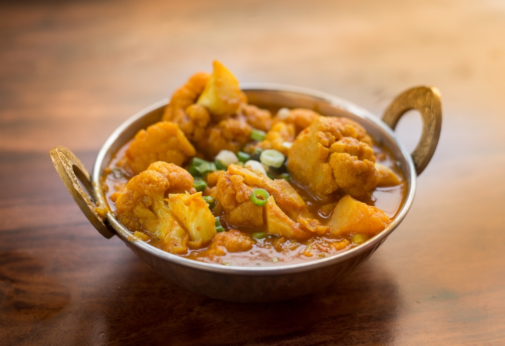 Aloo Cauli   Red Potato and fresh Cauliflower with toasted cumin, garnish with fresh cilantro and green onion.