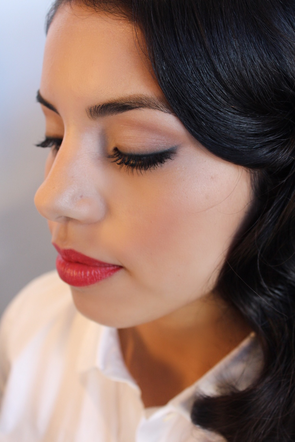 Bold Aveda lip in Goji Berry with simply defined eyes and brows.