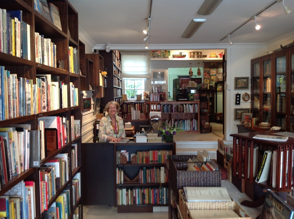 Margaret Dunstan surrounded by her stock of old and rare vintage books.