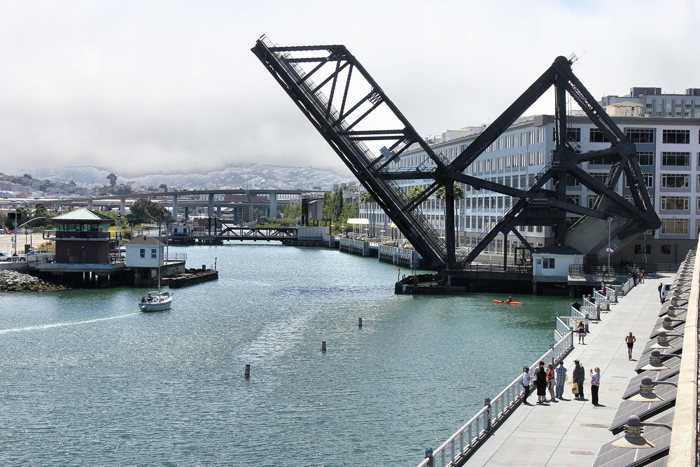 "The Fourth Street Bridge and the Francis ""Lefty"" O'Doul Bridge are both working drawbridges designed by J.B. Strauss, whose firm, the Bascule Bridge Co., later designed the Golden Gate Bridge."