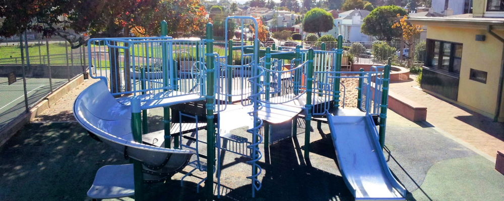 Junipero Serra Playground features a play area as well as a basketball court, tennis court, and a baseball field.