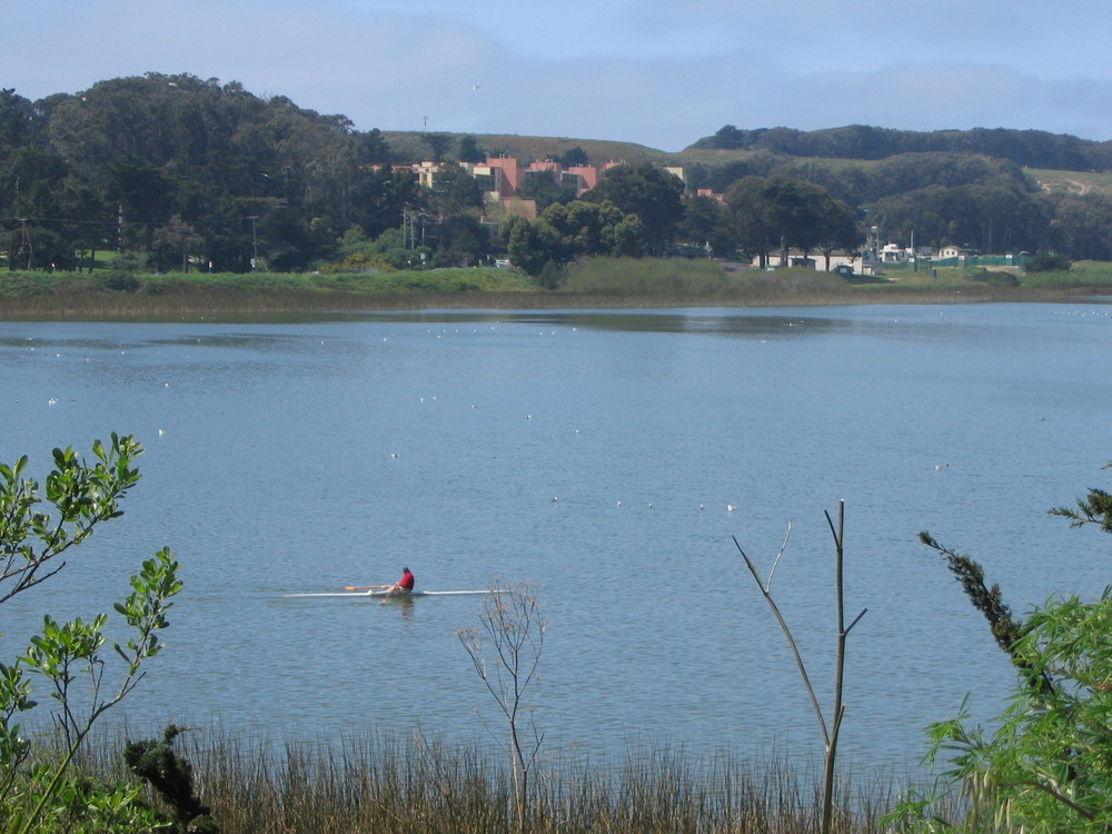 Lake Merced Park is a 614-acre outdoor area with a 4.5-mile recreational trail encircling a freshwater lake, popular for fishing, boating, jogging and biking.