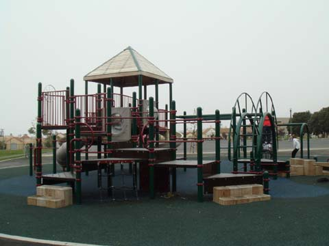 Aptos Park is an urban green space that contains a children's playground, baseball diamond, tennis court, and landscaped path.