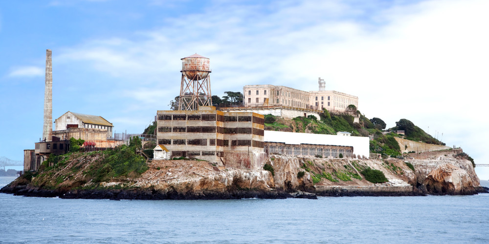 "A former federal prison, Alcatraz Island (a.k.a. ""the Rock"") is a major tourist attraction and can be seen from many points along the waterfront."