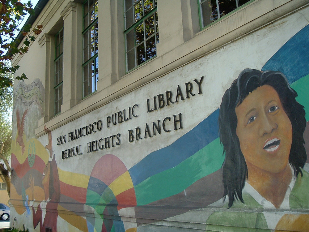 A vibrant mural, complete with a quote by singer/songwriter/social activist Holly Near, adorns the front of the Bernal Heights Public Library.