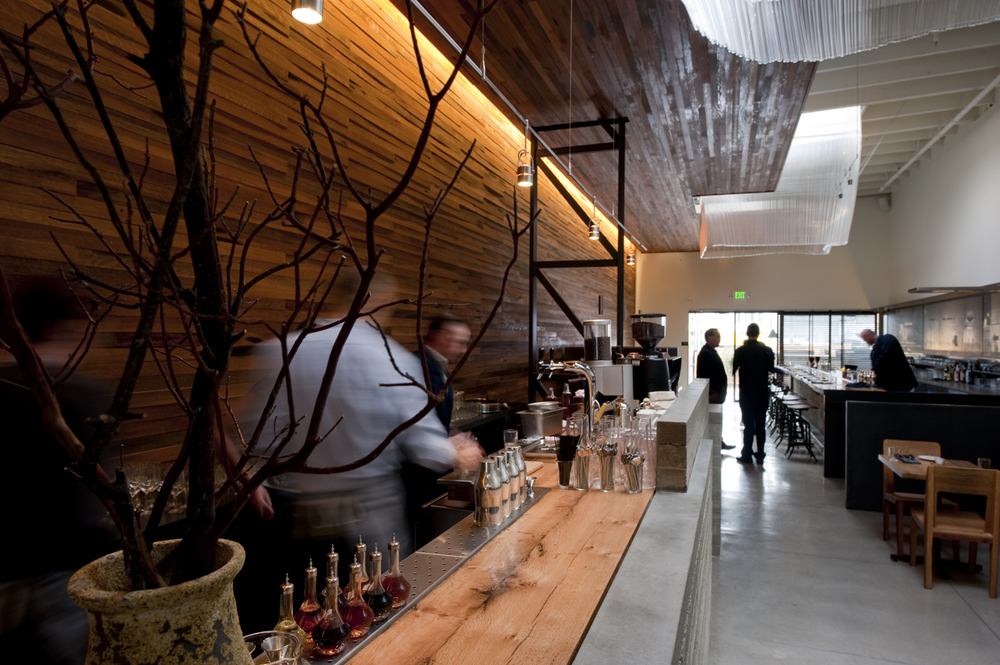 Bar Agricole is a sophisticated eatery known for its sultry architecture and inventive cocktails.