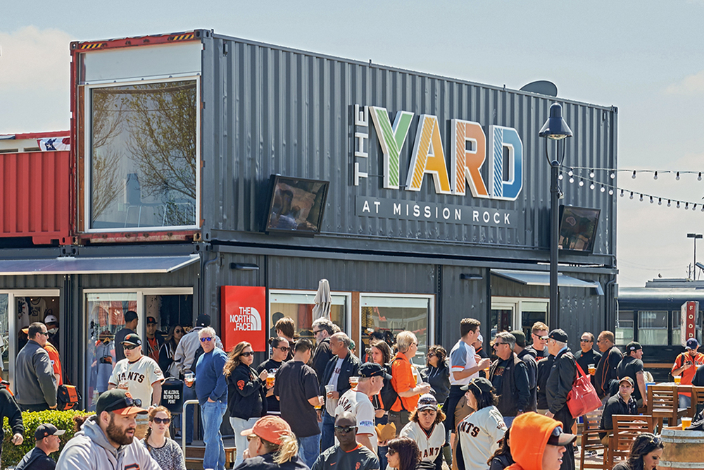 The Yard at Mission Rock is a pop-up village constructed from repurposed shipping containers that houses local food and drink establishments, retail shops and public open space.