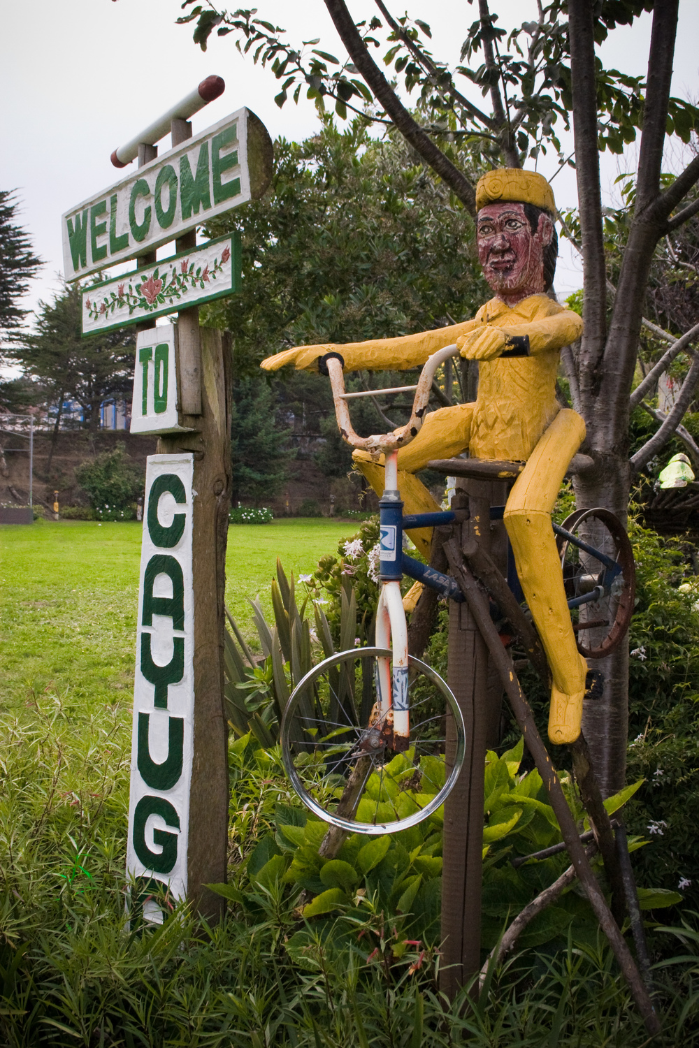 An employee of the San Francisco Recreation and Park Department worked on Cayuga Park for more than 20 years, transforming a barren landscape into a neighborhood recreation area with lush vegetation, walking trails, themed gardens, observation decks, and hundreds of hand-carved wooden figurines, totem poles and statues.
