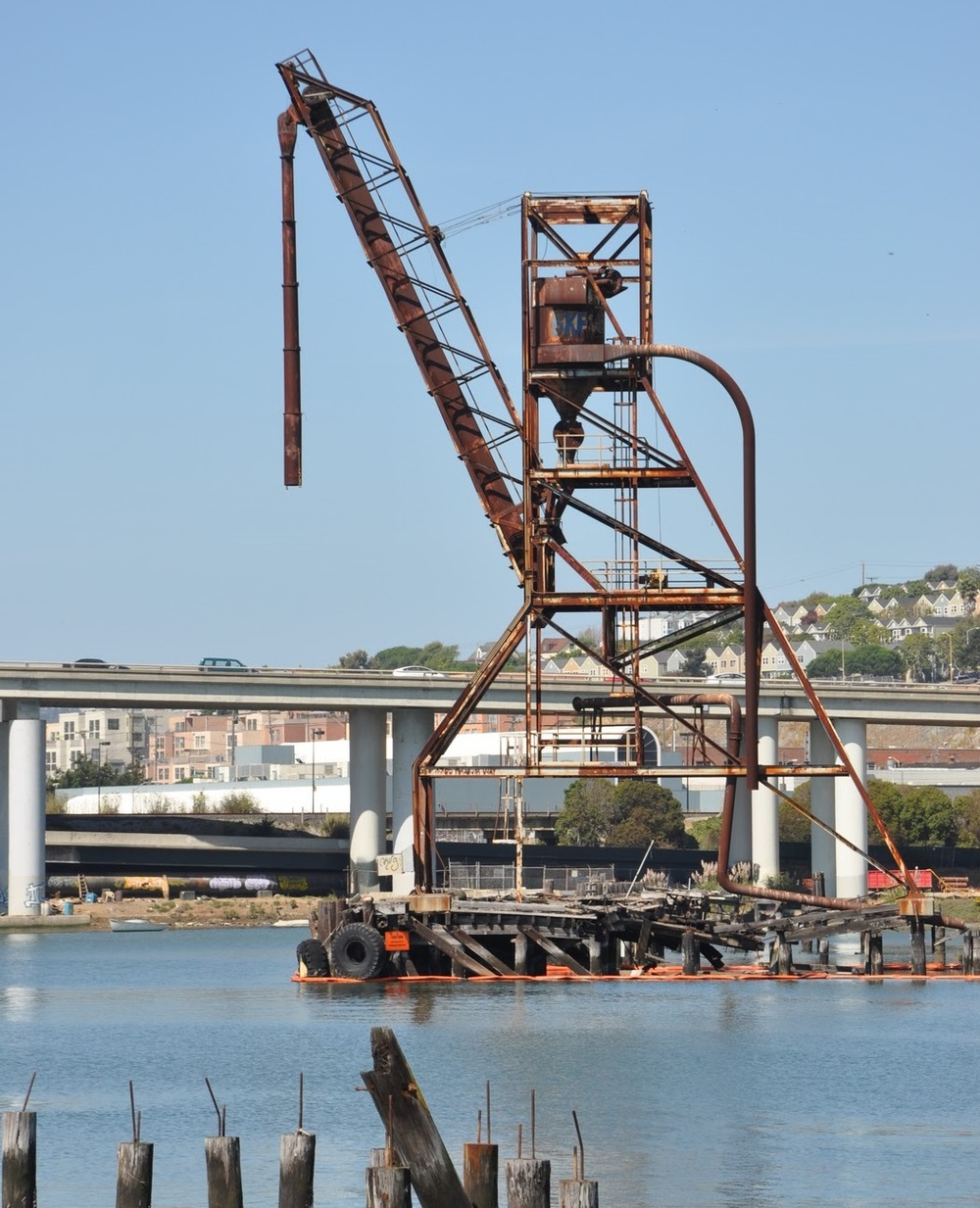 A towering old copra crane serves as the landmark for a new park at Islais Creek.