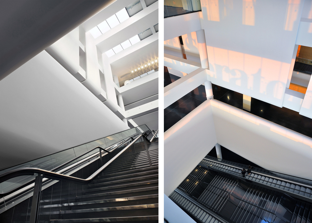 three storey stairwell  T  he escalator block down to the ground floor entrance and the false ceiling originating at the top floor level and serves as the conference centre reception.