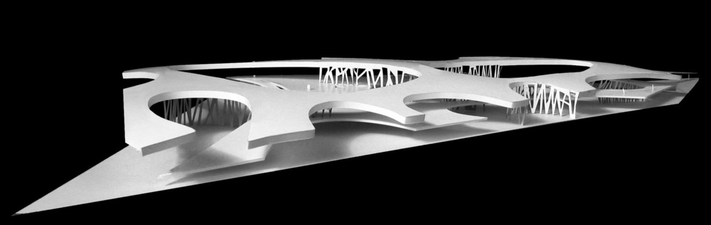 Study model of the building We have done this by imagining two irregularly perforated planes hovering over the ground: - the first, is a raised floor plane - the second, is the roof canopy arching over the entire area