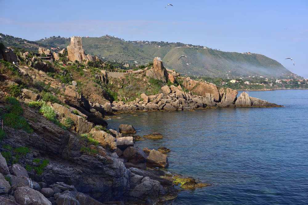 Santa Lucia cliff_view from the coast   Club Mediterranée is a holiday village with over sixty years history on the cliff of Santa Lucia near the charming and historic town of Cefalù in Sicily. At the sunset of its glorious days, Club Med came up with an ambitious plan in order to upgrade the whole site. The new design goes beyond an overhaul of the existing buildings which were mainly straw huts commissioning a high standard accomodation appropriate for a more demanding clientele. The outstanding natural beauty of the site offers breathtaking views of Cefalù and its surroundings. Over the years the infrastructure of the place has grown and been modified in some cases also taking care of the landscape strongly bound to the place.